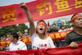 """A Chinese demonstrator attends a protest against Japan's """"nationalising"""" of Diaoyu Islands, known as the Senkakus in Japan. Photo: AFP"""