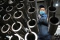 With raw materials getting more expensive over the past several months, China's factory-gate inflation rose by 9 per cent in July from a year earlier. Photo: AFP