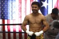 Manny Pacquiao poses for the media at Wild Card Boxing Club in Los Angeles. Photo: AFP
