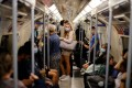 People travel on the Jubilee line of the London Underground. Photo: AFP