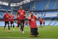 Manchester United's Portuguese midfielder Bruno Fernandes celebrates with teammates after scoring the during the English Premier League match against Manchester City. Photo: AFP