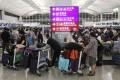 Passengers wait at check-in counters at Hong Kong International Airport. Photo: Edmond So