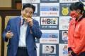 Nagoya Mayor Takashi Kawamura bites Japanese softball player Miu Goto's gold medal, prompting thousands of complaints to city hall. Photo: Kyodo News via AP