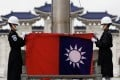 Taiwanese honour guards fold the island's flag during a flag-lowering ceremony in Taipei in June. Photo: EPA-EFE