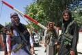 Taliban fighters stand guard near Zanbaq Square in Kabul. Photo: TNS