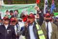 A Gurkha veteran speaks through a megaphone during a protest outside 10 Downing Street. Photo: Handout