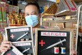 Raymond Shieh poses with his 'Hell Covid-19 Vaccine' set for the Hungry Ghost Festival at his shop in Johor Baru. Photo: Facebook
