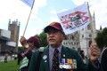 Former British Gurkha soldiers and their families protest outside parliament in London on Wednesday. Photo: EPA-EFE