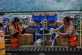 Employees work in the warehouse of Cainiao Smart Logistics Network, the logistics affiliate of e-commerce giant Alibaba, in Wuxi, China's eastern Jiangsu province. Photo: AFP