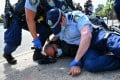Police tackle a protester during an anti-lockdown protest in Sydney on August 21, 2021. Photo: EPA-EFE