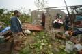 A resident surveys a damaged home in Tecolitla, Veracruz state. Photo: Bloomberg