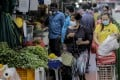 Shoppers at a market in Little India. Photo: EPA-EFE