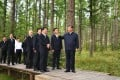 """Chinese President Xi Jinping checks the growth of trees and learns about the promotion of the """"Saihanba spirit"""" at a forest farm in Hebei province on Monday. Photo: Xinhua"""