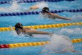 Hong Kong's Chan Yui-lam finishes first in the women's 100m butterfly S14 heat at the 2020 Paralympic Games in the Tokyo Aquatics Centre. Photos: Hong Kong Paralympic Committee