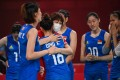 China's Ding Xia hugs head coach Lang Ping after their women's preliminary round pool B volleyball match between China and Argentina during the Tokyo 2020 Olympic Games at Ariake Arena in Tokyo. Photo: AFP