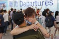 Family and friends bid farewell to loved ones in the departures hall at Hong Kong International Airport. Photo: Nora Tam