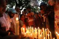 People attend a candlelight vigil following the rape and murder of a young girl in New Delhi earlier in August. Photo: Reuters