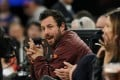 Actor Adam Sandler attends an NBA basketball game between the Boston Celtics and the New York Knicks in 2013. Photo: AP