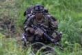 A Japanese soldier trains during a joint military drill with French and US forces in Japan's Miyazaki prefecture in May. Photo: Reuters