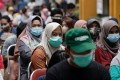 People wait to get vaccinated against Covid-19 in Jakarta on Tuesday. Indonesia is among the countries that have allowed phase 3 testing of a Chinese mRNA vaccine candidate. Photo: Reuters