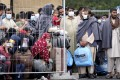 People stay next to a fence at the Ramstein US Air Base in Ramstein, Germany, on August 30. Photo: AP