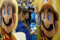 Mario, a character from Nintendo's Mario franchise, next to young players at the Legends of Gaming Live event in London on 15 September 2015. Photo: Bloomberg