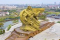 The infamous Guan Yu statue in Jingzhou City in China is finally being taken away after complaints it was ugly and exceeded local height restrictions. Photo: Handout