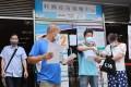 People queue for their coronavirus jabs at Kowloon Bay Sports Centre. Photo: May Tse