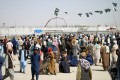 People gather to cross into Afghanistan at the Friendship Gate crossing point at the Pakistan-Afghanistan border town of Chaman, Pakistan, on Thursday. Photo: Reuters