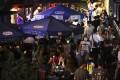 Hongkongers enjoy a Saturday night out at bars in Tsim Sha Tsui. Photo: Dickson Lee