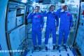 Three Chinese astronauts onboard the Shenzhou-12 spaceship saluting after entering the Tianhe space station core module in June. Photo: EPA-EFE/Xinhua/Jin Liwang