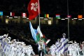 Badminton player Chu Man-kai of Hong Kong carries the flag during the closing ceremony of the Tokyo 2020 Paralympic Games. Photo: Reuters