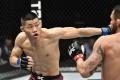 Li Jingliang punches Santiago Ponzinibbio in their welterweight UFC bout. Photo: Jeff Bottari/Zuffa LLC