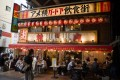 Customers dine at a restaurant on the Ameyoko shopping street in Tokyo, Japan. Photo: Bloomberg
