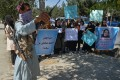 A Taliban fighter stands guard as Afghan women take part in a protest in Kabul on Wednesday. Photo: AFP