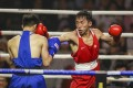 Rex Tso (red), who suffered a disappointing return to the ring after losing his first bout in 18 months to Wang Xinyan in the National Games round of 16 encounter, in action at the Southorn Stadium in Wan Chai. Photo: Winson Wong