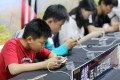 """Players competing in a match of the mobile game """"Honor of Kings"""" in the Hubei provincial capital of Wuhan on May 2018. Photo: Imaginechina"""