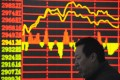 An investor monitors stock information on an electronic screen at a brokerage house in Taiyuan, Shanxi province, Photo: Reuters