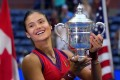 Britain's Emma Raducanu celebrates with the trophy after winning the 2021 US Open. Photo: AFP