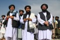 Taliban spokesman Zabihullah Mujahid (centre) speaks to reporters at the airport in Kabul on August 31, after the last US troops had pulled out. Photo: AFP
