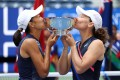 China's Zhang Shuai and Samantha Stosur of Australia celebrate with the championship trophy after defeating US pair Coco Gauff and Catherine McNally in the 2021 US Open women's doubles final. Photo: AFP