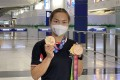 Track cycling star Sarah Lee returns home after a two-month campaign, which included the Tokyo Olympic Games and the National Games. Photo: Chan Kin-wa