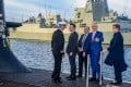 French President Emmanuel Macron (second left) and former Australian prime minister Malcolm Turnbull (second right) stand on the deck of a submarine operated by the Australian navy in Sydney. File photo: AFP