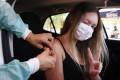 A woman receives a jab of the CoronaVac vaccine in Brasilia. Photo: AFP