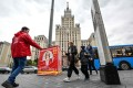 An activist runs a campaign event for a Russian Communist Party candidate in Moscow on Thursday. Photo: AFP