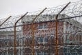 A barbed wire fence is seen outside inmate housing on New York's Rikers Island correctional facility in March 2011. Photo: AP