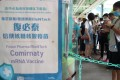 People queue to get the BioNTech vaccine at Choi Hung Road Badminton Centre. Photo: Edmond So