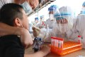 A child is tested for Covid-19 in Xiamen, one of three cities affected by an outbreak of the Delta variant in Fujian province. Photo: AFP