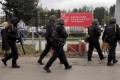 Law enforcement officers at Perm State University after a shooting. Photo: Reuters
