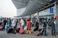 Travellers wearing face masks arrive at an airport in Kolkata, India, amid the pandemic. Photo: Bloomberg